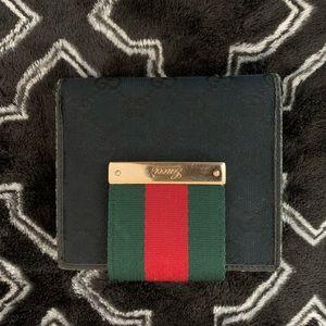 Gucci canvas bi fold wallet